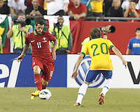 Portugal forward Vieirinha (11) passes the ball.  In an international friendly, Brazil (yellow/blue) defeated Portugal (red), 3-1, at Gillette Stadium on September 10, 2013.