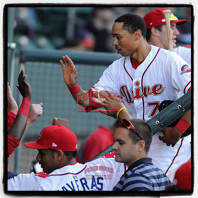 #OTD On This Day, April 25, 2013, Mookie Betts (7) of the Greenville Drive was congratulated after scoring a run in a game against Lakewood at Fluor Field at the West End in Greenville, South Carolina. Betts scored four runs as Greenville won, 12-1. (Tom Priddy/Four Seam Images) #MiLB #OnThisDay #MissingBaseball #RedSox #Baseball #SallyLeague #AloneTogether