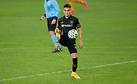 CARSON, CA - OCTOBER 28: Eduard Atuesta #20 of LAFC traps a ball during a game between Houston Dynamo and Los Angeles FC at Banc of California Stadium on October 28, 2020 in Carson, California.
