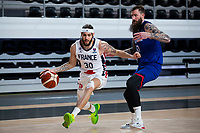 22nd February 2021, Podgorica, Montenegro; Eurobasket International Basketball qualification for the 2022 European Championships, England versus France;  Isaia Cordinier of France goes past Gareth Murray (GBR)