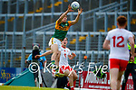 Paul O'Shea, Kerry, goes highest in an aerial duel over Kieran McGeary, Tyrone, during the Allianz Football League Division 1 Semi-Final, between Tyrone and Kerry at Fitzgerald Stadium, Killarney, on Saturday.