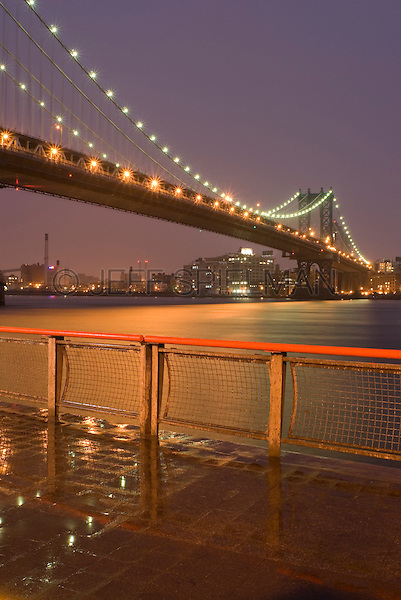 AVAILABLE FROM JEFF AS A FINE ART PRINT.<br /> <br /> AVAILABLE FROM JEFF FOR COMMERCIAL AND EDITORIAL LICENSING.<br /> <br /> Manhattan Bridge and East River Illuminated at Dusk in the Rain, Lower Manhattan, New York City, New York State, USA