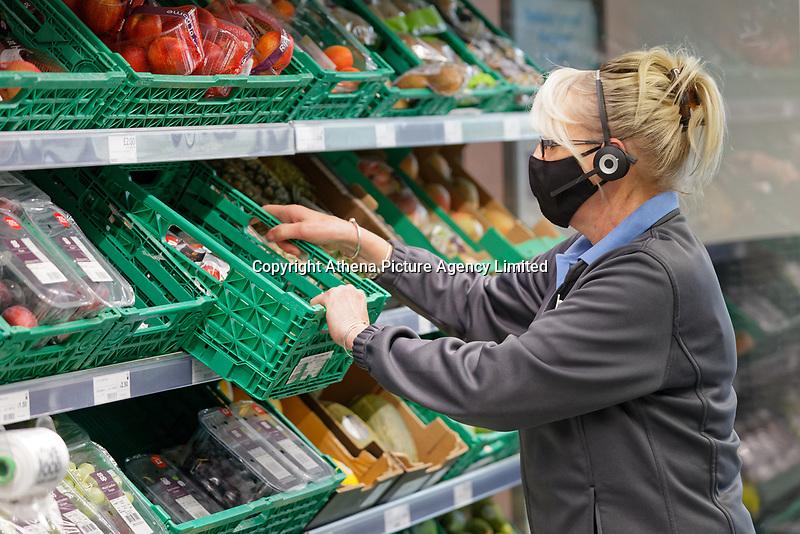 Vanessa Davies stocking shelves.