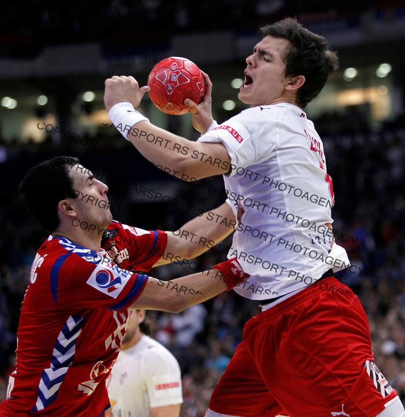Rasmus Lauge Schmidt (R) of Denmark and Marko Prodanovic (L) of Serbia in action during men`s EHF EURO 2012 handball championship final game between Serbia and Denmark in Belgrade, Serbia, Sunday, January 29, 2011.  (photo: Pedja Milosavljevic / thepedja@gmail.com / +381641260959)