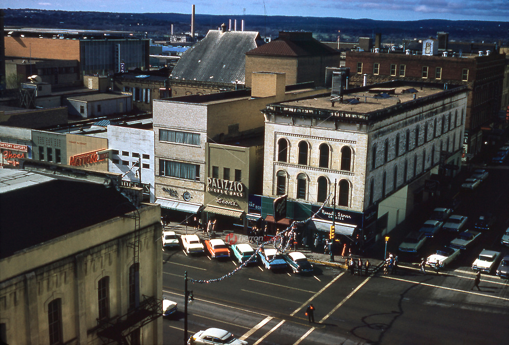 Historical rooftop view in December 1961 of retail shops along Congress Avenue in downtown Austin, Texas. This vintage image was shot on 35mm Kodak slide film.