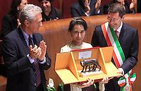 L'attivista birmana e vincitrice del Premio Nobel per la Pace del 1991 Aung San Suu Kyi riceve la cittadinanza onoraria di Roma durante una cerimonia col sindaco Ignazio Marino, a destra, e l'ex sindaco Francesco Rutelli, in Campidoglio, Roma, 27 ottobre 2013.<br /> Burmese opposition leader and Nobel Prize laureate Aung San Suu Kyi, center, attends a ceremony with Rome's Mayor Ignazio Marino, right, and former Mayor Francesco Rutelli, to receive the honorary citizenship at the Campidoglio city hall in Rome, 27 October 2013.<br /> UPDATE IMAGES PRESS/Isabella Bonotto