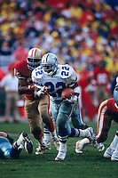 SAN FRANCISCO, CA - Emmitt Smith of the Dallas Cowboys in action against the San Francisco 49ers in the NFC Championship game at Candlestick Park in San Francisco, California in January of 1993. Photo by Brad Mangin.