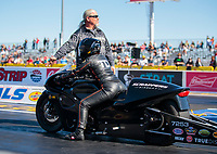 Nov 1, 2019; Las Vegas, NV, USA; NHRA pro stock motorcycle rider Jianna Salinas with crew during qualifying for the Dodge Nationals at The Strip at Las Vegas Motor Speedway. Mandatory Credit: Mark J. Rebilas-USA TODAY Sports