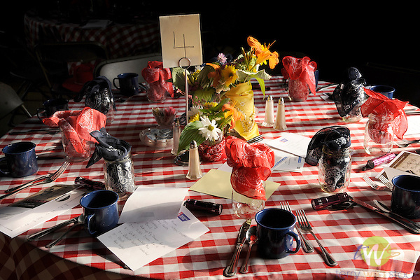 Table setting for country hoedown in barn.