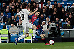 Real Madrid's Alvaro Odriozola and SD Huesca's Samuele Longo during La Liga match between Real Madrid and SD Huesca at Santiago Bernabeu Stadium in Madrid, Spain.March 31, 2019. (ALTERPHOTOS/A. Perez Meca)