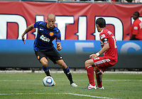 Manchester United midfielder Gabriel Obertan (26) maneuvers away from Chicago Fire defender Gonzalo Segares (13).  Manchester United defeated the Chicago Fire 3-1 at Soldier Field in Chicago, IL on July 23, 2011.
