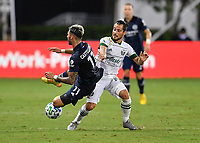 LAKE BUENA VISTA, FL - AUGUST 01: Valentín Castellanos #11 of New York City FC is tripped by Sebastián Blanco #10 of the Portland Timbers during a game between Portland Timbers and New York City FC at ESPN Wide World of Sports on August 01, 2020 in Lake Buena Vista, Florida.