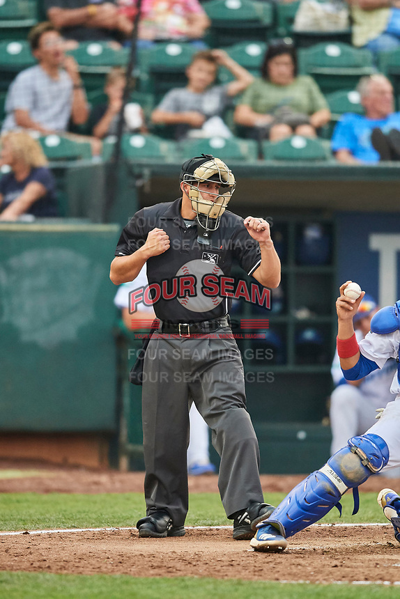 Umpire John Perez handles the calls behind the plate during a game between the Ogden Raptors and the Orem Owlz at Lindquist Field on August 4, 2018 in Ogden, Utah. The Owlz defeated the Raptors 15-12. (Stephen Smith/Four Seam Images)