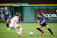 TACOMA, WA - JULY 31: Lauren Barnes #3 of the OL Reign dribbles the ball during a game between Racing Louisville FC and OL Reign at Cheney Stadium on July 31, 2021 in Tacoma, Washington.