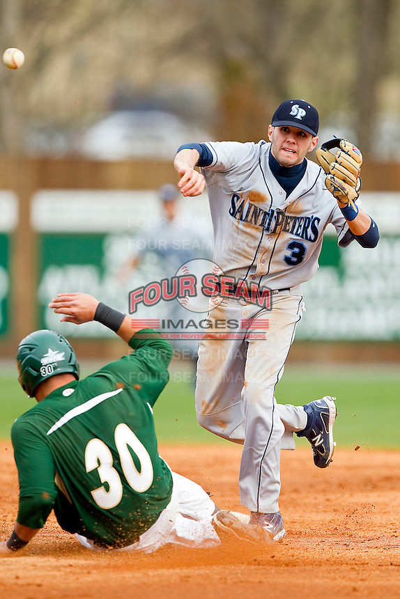 Shortstop Alberto Rodriguez #3 of the Saint Peter's Peacocks turns a double play as Miguel Rodriguez #30 of the Charlotte 49ers slides into second base at Robert and Mariam Hayes Stadium on February 18, 2012 in Charlotte, North Carolina.  Brian Westerholt / Four Seam Images