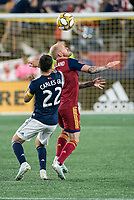 FOXBOROUGH, MA - SEPTEMBER 21: Luke Mulholland #19 of Real Salt Lake and Carles Gil #22 of New England Revolution compete for a high ball during a game between Real Salt Lake and New England Revolution at Gillette Stadium on September 21, 2019 in Foxborough, Massachusetts.
