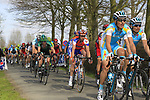 The peloton approaches the start of the Oude Kwaremont climb during the 96th edition of The Tour of Flanders 2012, running 256.9km from Bruges to Oudenaarde, Belgium. 1st April 2012. <br /> (Photo by Eoin Clarke/NEWSFILE).