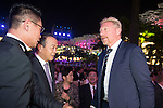 Boris Becker (right) during the Opening Ceremony of the the World Celebrity Pro-Am 2016 Mission Hills China Golf Tournament on 20 October 2016, in Haikou, China. Photo by Weixiang Lim / Power Sport Images