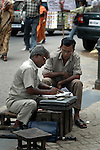 A man helping an illiterate person to fill up an official form against which he will charge his customers a small amount.  With this profession the man earns about 3 USD a day. Kolkata, West Bengal,  India  7/18/2007.  Arindam Mukherjee/Landov