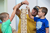 Sawyer Deathe, 5, (from left), Dustin Deathe and Porter Deathe, 7, of Lawrence, Kans. use Keva planks to build a tower, Friday, July 16, 2021 at the Amazeum in Bentonville. The Amazeum's latest exhibit Creativity Cubed: Think Outside the Blocks, created by the Amazeum team, invites guests to explore their own creativity through a timeless medium - the block. Blocks are infinitely adaptable to the imagination of the user. Check out nwaonline.com/210717Daily/ for today's photo gallery. <br /> (NWA Democrat-Gazette/Charlie Kaijo)
