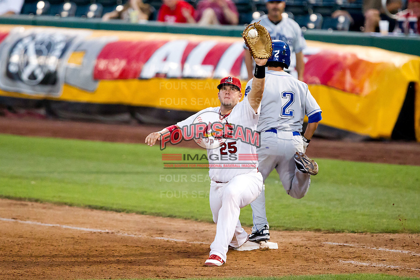Matt Adams (25) of the Springfield Cardinals stretch for the ball as Thomas Field (2) of the Tulsa Drillers is safe during a game against the Tulsa Drillers at Hammons Field on July 20, 2011 in Springfield, Missouri. Springfield defeated Tulsa 12-1. (David Welker / Four Seam Images)