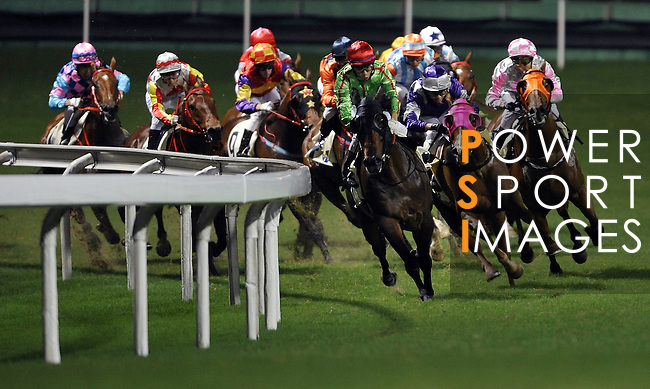 HONG KONG, CHINA - SEPTEMBER 16:  Runners come round the final bend in the Race 7 during the first night of horses races of the 2009/10 seasson at the Happy Valley racecourse in Hong Kong. The coming 2009/10 racing season marks the 125th Anniversary of The Hong Kong Jockey Club, which since its establishment in 1884. Photo by Victor Fraile / The Power of Sport Images