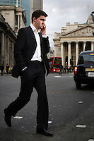 Ross Gray, who works at the London Stock Exchange (LSE), passing the Royal Exchange in the City of London. The UK went into recession in the final quarter of 2008 as the City was hit hard by the global credit crunch.
