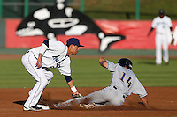 Lonnie Kauppila #38 of the Everett AquaSox tags out Kyle Von Tungeln #14 of the Tri-City Dust Devils at second base during a game at Everett Memorial Stadium on July 24, 2013 in Everett, Washington. Tri-City defeated Everett, 3-1. (Larry Goren/Four Seam Images)
