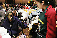 Beer is poured at the the New Orleans annual Thanksgiving feast for the homeless and elderly on November 25, 2004.  Organized by the city's Sheriff Marlin, free Thanksgiving meals and pitchers of beer were consumed by over five thousand people.