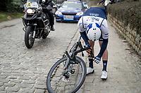 Tom Van Asbroeck (BEL/Israel Start-Up Nation) breaking off his handlebars over the 2nd cobbled section of teh day<br /> <br /> 76th Omloop Het Nieuwsblad 2021<br /> ME(1.UWT)<br /> 1 day race from Ghent to Ninove (BEL): 200km<br /> <br /> ©kramon