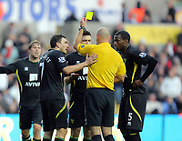 Saturday, 08 December 2012<br /> Pictured: A Norwich player sees a yellow card by match referee H Webb for his foul on Michu.<br /> Re: Barclays Premier League, Swansea City FC v Norwich City at the Liberty Stadium, south Wales.