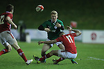 Ireland full back Stuart Olding spills the ball as Wales wing Ashton Hewitt makes the tackle..Under 20 Six Nations.Wales v Ireland.Eirias - Colwyn Bay.01.02.13.©Steve Pope