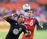 Dwayne De Rosario (7) of D.C. United takes control of the ball in front of Terry Dunfield (23) of Toronto FC during the game at RFK Stadium in Washington, DC.  D.C. United tied Toronto FC, 3-3.