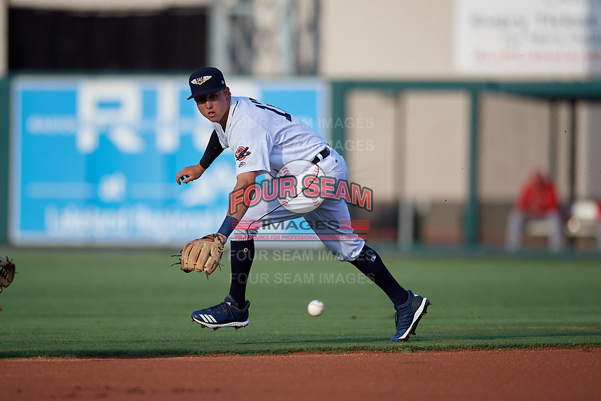 Lakeland Flying Tigers second baseman A.J. Simcox (12) attempts to field a ground ball during a Florida State League game against the Palm Beach Cardinals on April 17, 2019 at Publix Field at Joker Marchant Stadium in Lakeland, Florida.  Lakeland defeated Palm Beach 1-0.  (Mike Janes/Four Seam Images)
