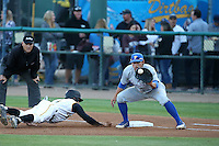 Kyle Plantier (22) of the UC Santa Barbara Gauchos takes a throw at first base during a game against the Cal State Long Beach Dirtbags at Blair Field on April 1, 2016 in Long Beach, California. UC Santa Barbara defeated Cal State Long Beach, 4-3. (Larry Goren/Four Seam Images)