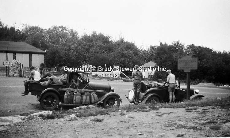 Harrisonville PA:  County Workers driving a 1929 Chevrolet International Sport Cabriolet and a 1931 Chevrolet 1/2 ton truck breaking for lunch on Sideling Hill Summit.  This section of the Lincoln Highway, Route 30 has an elevation of 2195 feet.