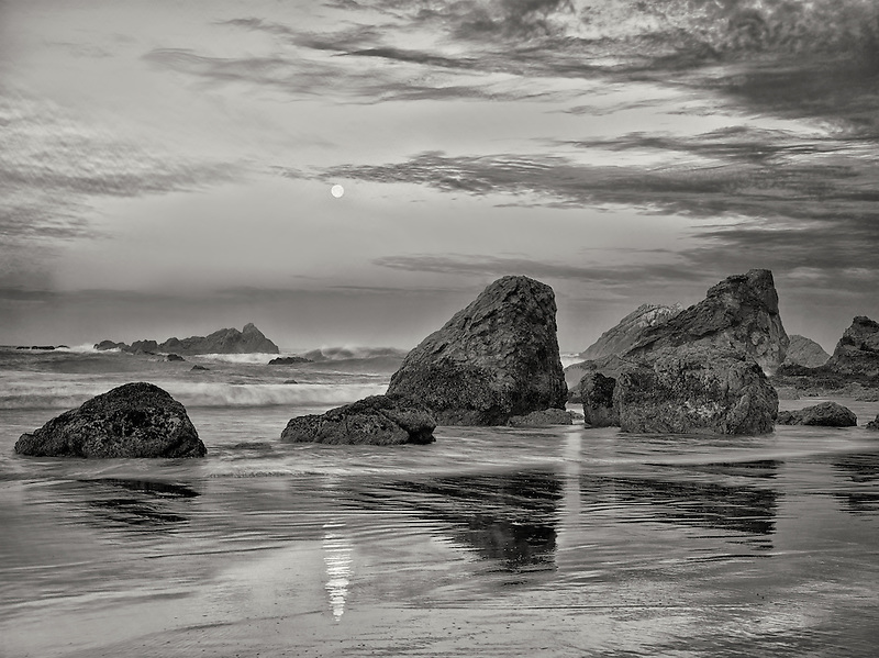 Sunrise and full moonset with reflection at Harris Beach State Park, Oregon