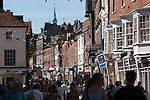 Great Britain, England, Hampshire, Winchester: Shoppers and shops along the Broadway