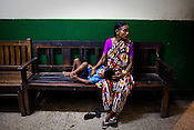 A mother is seen waiting outside the doctors' clinic in Maharani Laxmibai Medical College in Jhansi, Uttar Pradesh, India. The Indian government spends $1.4 billion a year - on programs that include weighing newborn babies, counseling mothers on healthy eating and supplementing meals, but none of this is yeilding results. According to UNICEF, some 48% of Indian children, or 61 million kids, remain malnourished, the clinical condition of being so undernourished that their physical and mental growth are stunted. Photo: Sanjit Das/Panos for The Wall Street Journal.Slug: IMALNUT