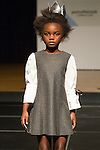 Model walks runway in an outfit by Bleu Comme Gris, during the petitePARADE Children's Club fashion show at the Jacob Javits Center in New York City, on January 9, 2016. Model walks runway in an outfit by Carlucci, during the petitePARADE Children's Club fashion show at the Jacob Javits Center in New York City, on January 9, 2016.