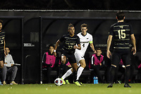 WINSTON-SALEM, NC - DECEMBER 01: Calvin Harris #22 of Wake Forest University is defended by Joel Harrison #4 of the University of Michigan during a game between Michigan and Wake Forest at W. Dennie Spry Stadium on December 01, 2019 in Winston-Salem, North Carolina.