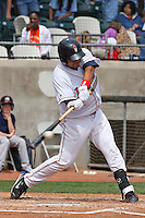 Richard Martinez #41 of the Kinston Indians hitting during a game against the Lynchburg Hillcats at Granger Stadium on April 28, 2010 in Kinston, NC. Photo by Robert Gurganus/Four Seam Images.