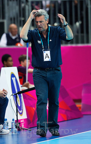 08 AUG 2012 - LONDON, GBR - Claude Onesta (FRA), the head coach of France, struggles to watch his team during the men's London 2012 Olympic Games quarter final match against Spain at the Basketball Arena in the Olympic Park, in Stratford, London, Great Britain (PHOTO (C) 2012 NIGEL FARROW)