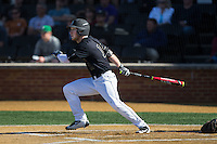 Jonathan Pryor (11) of the Wake Forest Demon Deacons follows through on his swing against the Florida State Seminoles at David F. Couch Ballpark on April 16, 2016 in Winston-Salem, North Carolina.  The Seminoles defeated the Demon Deacons 13-8.  (Brian Westerholt/Four Seam Images)