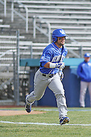 University of Kentucky Wildcats left fielder Ka'ai Tom (25) at bat during a game against the Ball State Cardinals at Brooks Field on the campus of University of North Carolina-Wilmington on February 13, 2015 in Wilmington, North Carolina. Kentucky defeated Ball State 11-7. (Robert Gurganus/Four Seam Images)