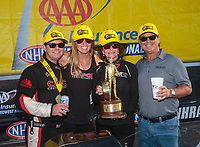 Sep 23, 2018; Madison, IL, USA; NHRA top fuel driver Steve Torrence (left) celebrates with mother Kay Torrence (center) and father Billy Torrence after winning the Midwest Nationals at Gateway Motorsports Park. Mandatory Credit: Mark J. Rebilas-USA TODAY Sports