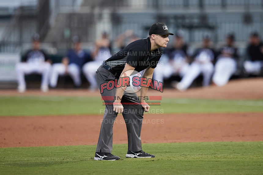 Umpire Tyler Witte handles the calls on the bases during the game between the Asheville Tourists and the Winston-Salem Dash at Truist Stadium on September 17, 2021 in Winston-Salem, North Carolina. (Brian Westerholt/Four Seam Images)