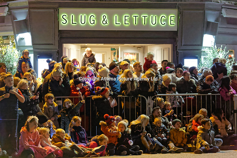 """Pictured: Locals gather at Castle Street to watch the Christmas parade in Swansea, Wales, UK. Sunday 19 November 2018<br /> Re: Swansea Christmas parade attended by thousands has been branded a """"shambles"""" for having just three floats.<br /> The annual festive event in south Wales, which took place on Sunday, promised """"dynamic dance-troupes"""" as well as """"spectacular shows and stages"""".<br /> But the parade was scaled down, leading to a barrage of criticism on social media because of roadworks in the city centre. <br /> The leader of Swansea Council, Rob Stewart apologised on Facebook and said the parade was not """"good enough"""".<br /> Parents took on social media to voice their anger, calling the event """"a load of rubbish"""" and claiming there was nothing for young children apart from """"a loud music float with Santa on""""."""