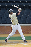 Will Craig (22) of the Wake Forest Demon Deacons follows through on his swing against the Marshall Thundering Herd at Wake Forest Baseball Park on February 17, 2014 in Winston-Salem, North Carolina.  The Demon Deacons defeated the Thundering Herd 4-3.  (Brian Westerholt/Four Seam Images)