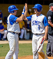 Shortstop Bruce Caldwell (9) of the Spartanburg Methodist College is congratulated by Robbie Dodds (36) after scoring a run in the second inning in a game against Stanly Community College on April 25, 2012, in Spartanburg, South Carolina. SMC won 17-2. Caldwell was named 2012 NJCAA Region 10 player of the year. (Tom Priddy/Four Seam Images)